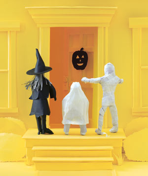 Paper construction of kids in Halloween costumes by Matthew Sporzynski