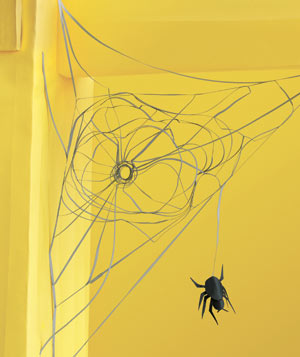 Paper construction of a spiderweb by Matthew Sporzynski