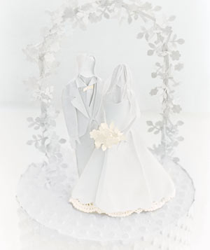 Paper construction of bride and groom cake topper by Matthew Sporzynski