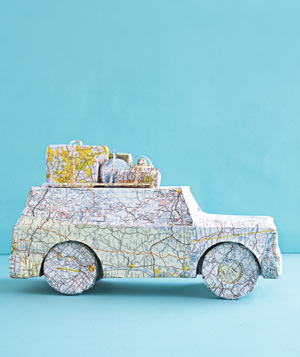 Paper construction of a car with luggage on roof by Matthew Sporzynski