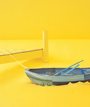 Paper construction of a row boat tied to dock by Matthew Sporzynski