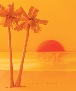 Paper construction of palm trees and sunset by Matthew Sporzynski