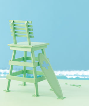 Paper construction of a lifeguard chair and rescue board by Matthew Sporzynski