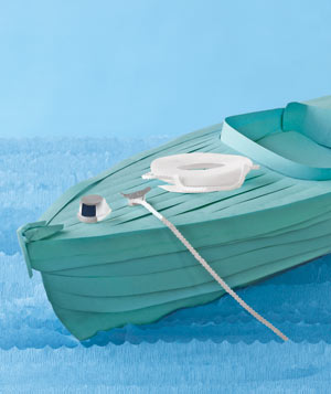 Paper construction of a boat on water by Matthew Sporzynski