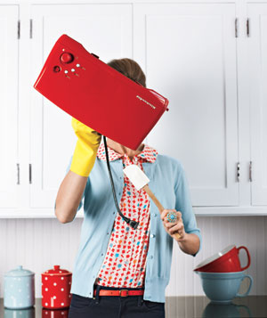 Woman cleaning a toaster