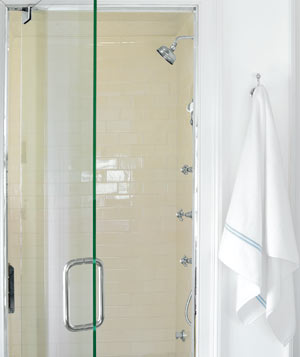 Glass shower door in bathroom