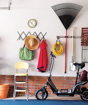 Mini Mudroom in a garage with a scooter