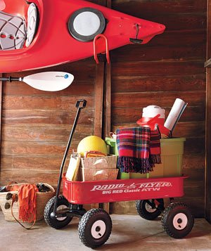 Kayak and Radio Flyer Wagon in garage