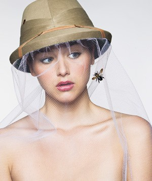 Woman wearing bug net