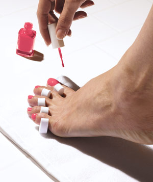 Pedicure with bright pink polish