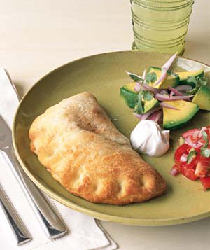 Skip the tacos and try made-with-pizza-dough empanadas packed with beans, cheese, and salsa.