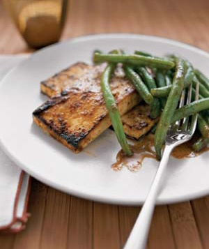 Tofu is high in protein, but it can be bland. A dose of Thai red curry paste solves the problem.