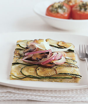 Think of this as a streamlined version of a Sicilian pie, with mushrooms, red onion, and finely sliced zucchini.