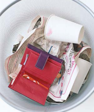 wallet in garbage can