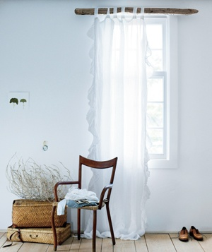 curtains and a chair in light