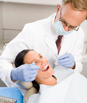 Male dentist examining woman