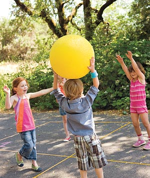Organize a game of four square, with chalk, a ball, and at least four players.