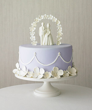 Purple Cake With Bride And Groom Topper