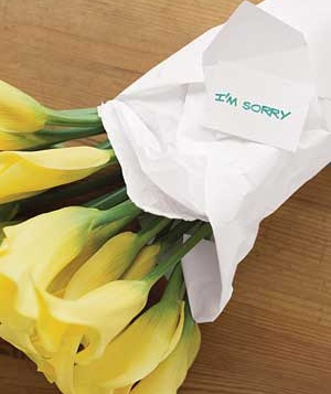 Yellow flowers with an apology note