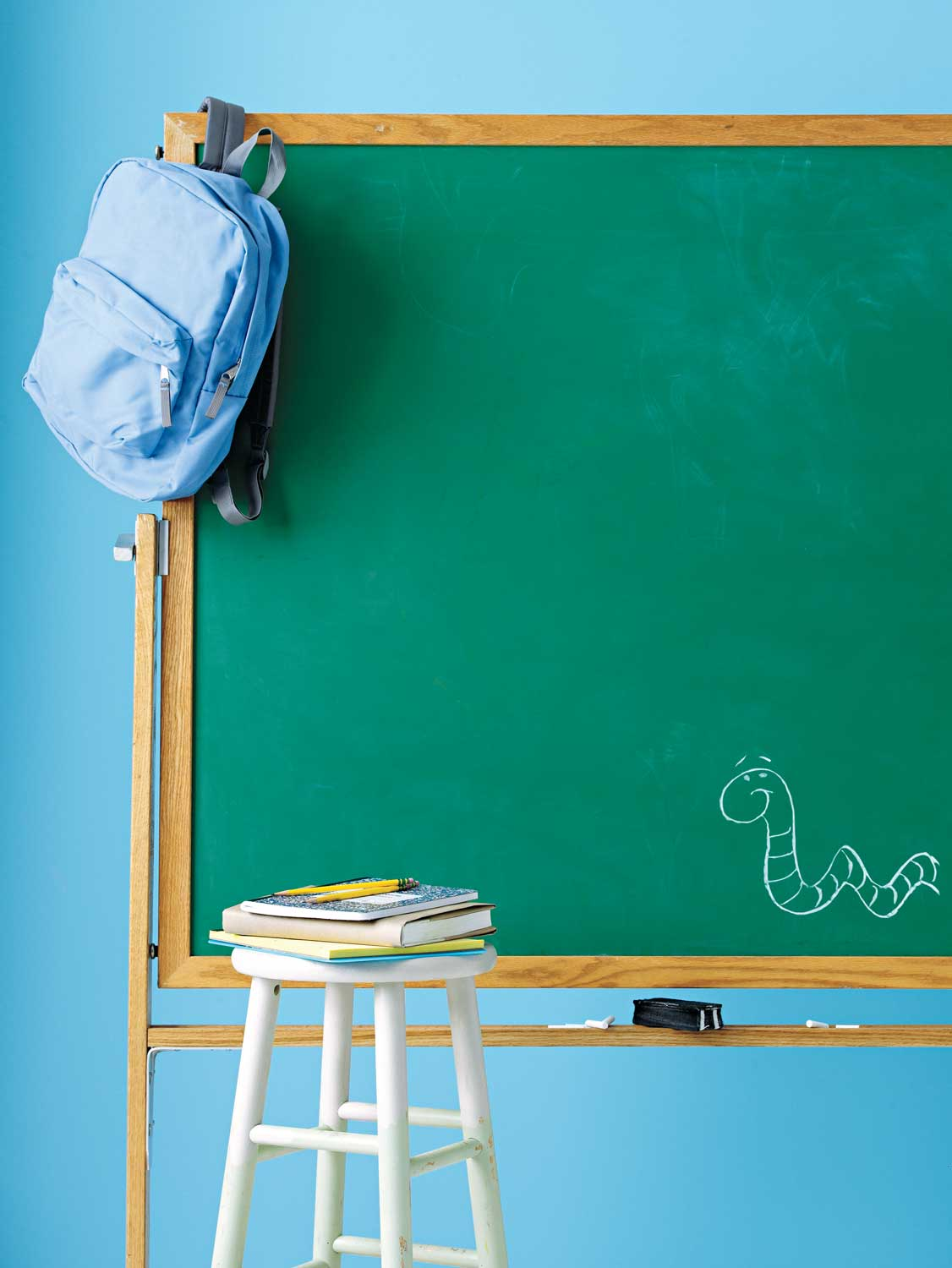 Chalkboard and school books