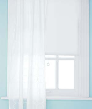 Windows with white curtains
