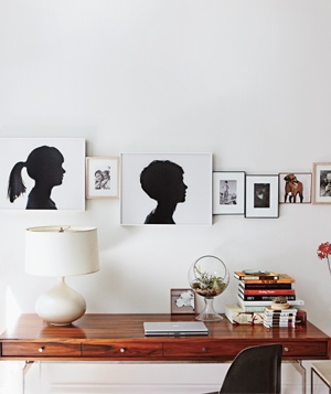 Portraits above desk