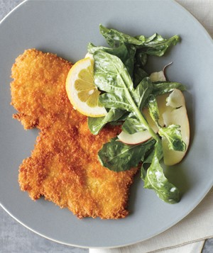 Crispy pork cutlets with arugula