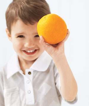 Boy holds orange