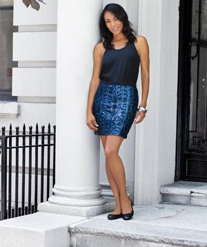 Elan Carter wearing a sequin skirt