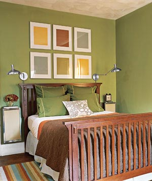 green bedroom with wood bedframe