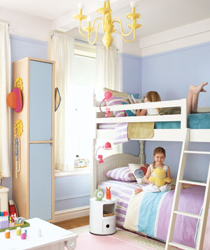 Two girls on bunk beds in an organized clean children's room