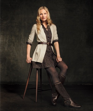 Seated model wearing boots