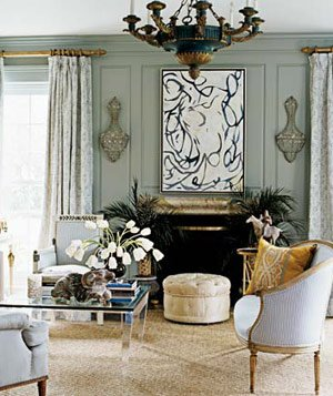 Sitting Room With Gray Walls, Antique Chairs, Glass Table And Fireplace