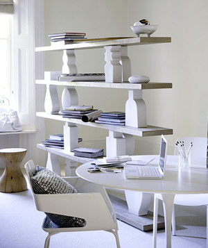 Modern room with light gray walls and floor, white table and chairs, sculptural shelving unit