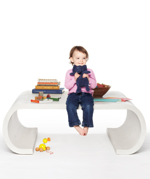 Child sitting on a coffee table