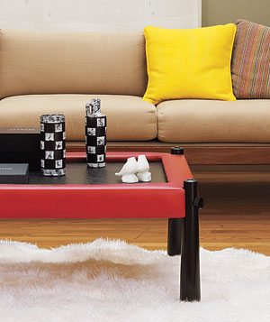 Yellow pillows and red-framed coffee table