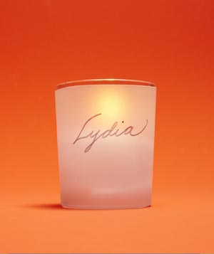 Votive candle holders as place cards