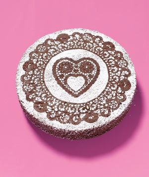 Cake decorated with a paper doily