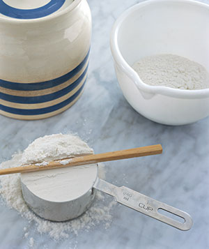 Cup of flour leveled with a chopstick