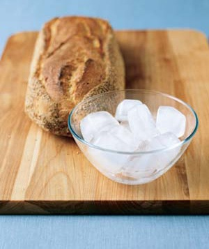 a loaf of bread and a bowl of ice cubes