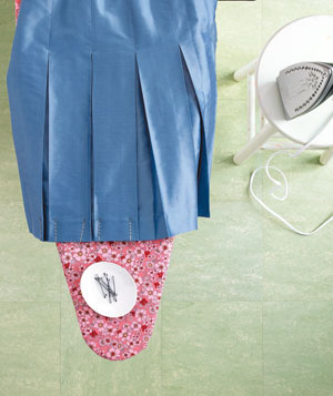 Bobby pins bolding pleats in place while ironing