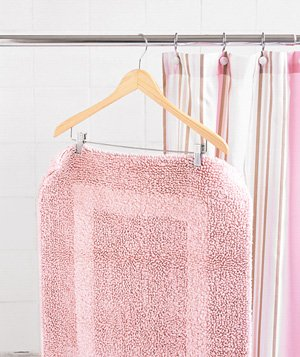 Pant hanger used to dry bath mat