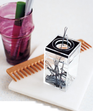 Paper clip dispenser used to stash bobby pins