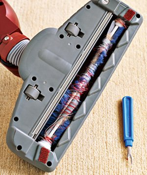 Seam ripper used to clean vacuum cleaner