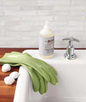 Cotton balls, rubber gloves and soap on a sink