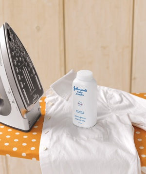 Baby powder, white shirt and iron on an ironing board
