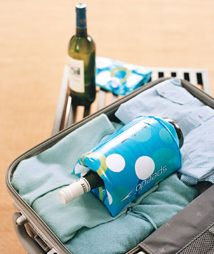Kids' floaties around a wine bottle