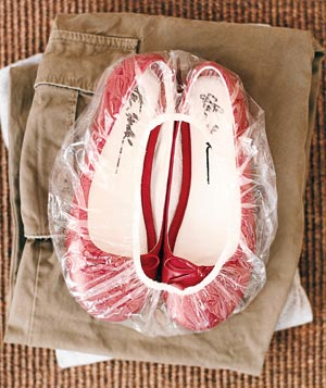 Red shoes in a clear plastic shower cap