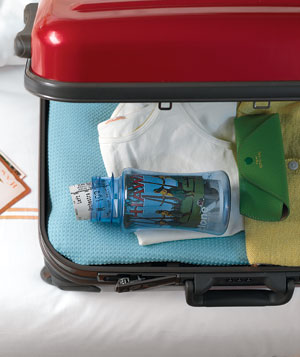 Water bottle in red suitcase
