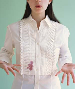 woman with stain on her blouse